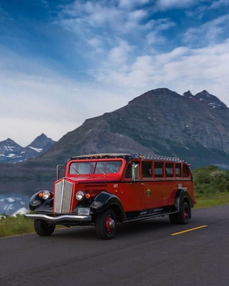 Glacier National Park's famous red jammer drives along Going-to-the-Sun Road