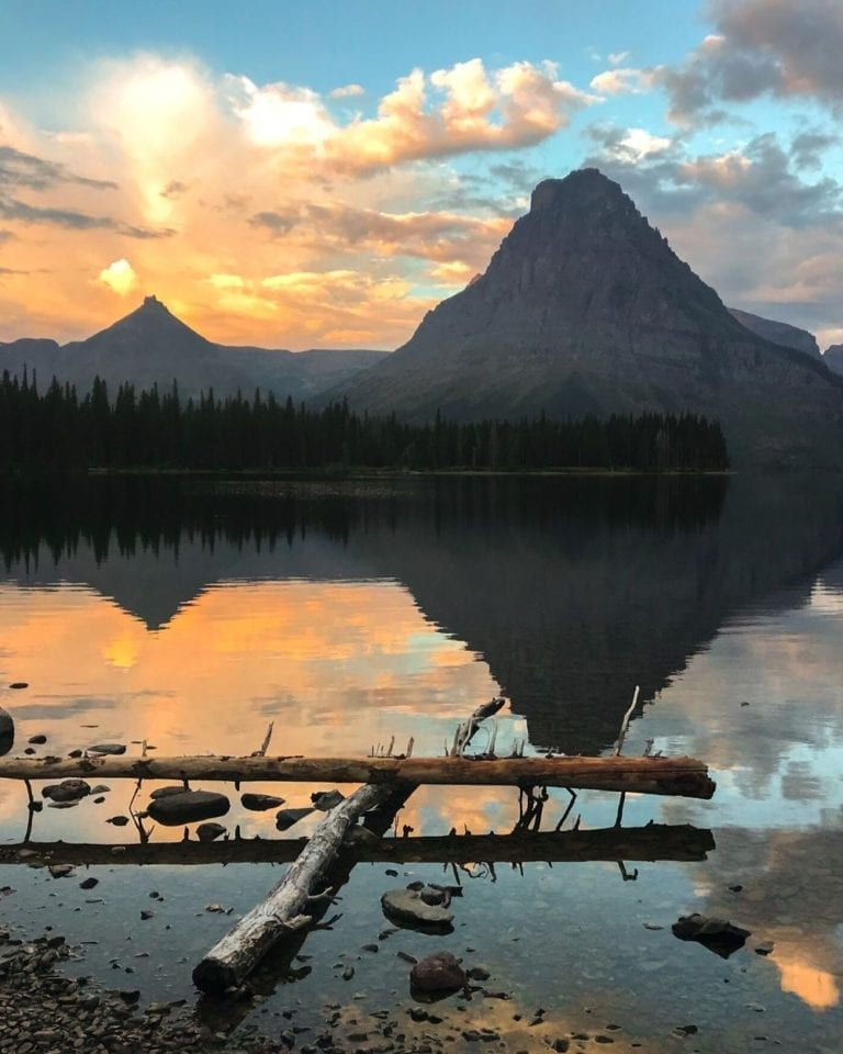 Orange sunrise over Two Medicine Lake in Glacier National Park