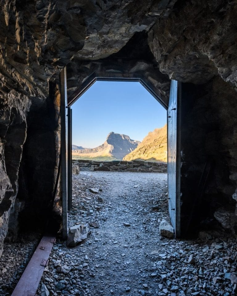 The morning sun shines through the doors of the Ptarmigan Tunnel