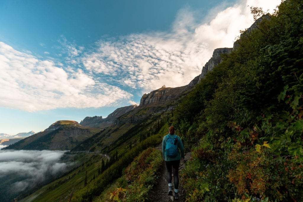 A hiker walks along the Highline Trail in Glacier National Park.