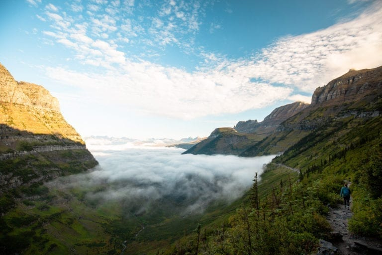 Low hanging fog fills the valley along the Highline Trail in Glacier National Park.