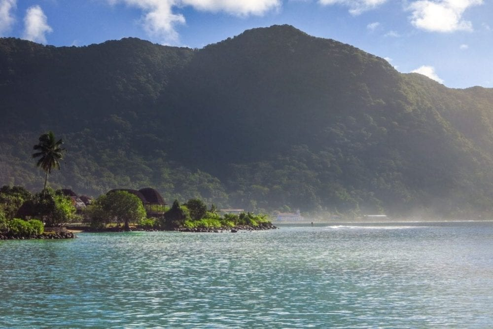 Teal blue water surrounds the island of Pago Pago in National Park of American Samoa