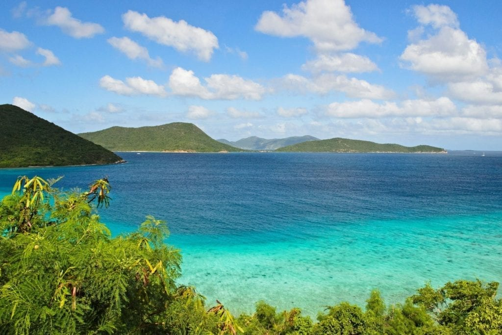 Bright teal blue water surrounds the island of St. John in Virgin Islands National Park