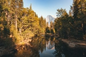Half Dome is reflected in the Merced River as seen from Sentinel Bridge in Yosemite Valley