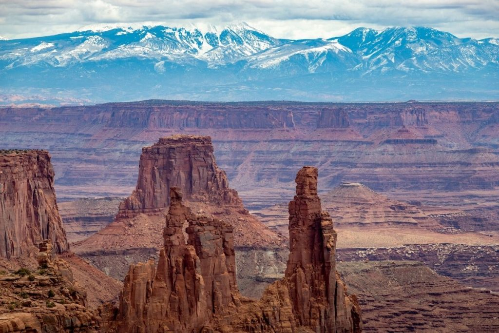 Rock formations and mountains in the distance in Canyonlands